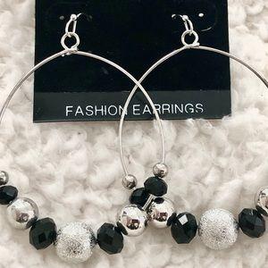 Taramanda Fashion loop Earrings with silver toned